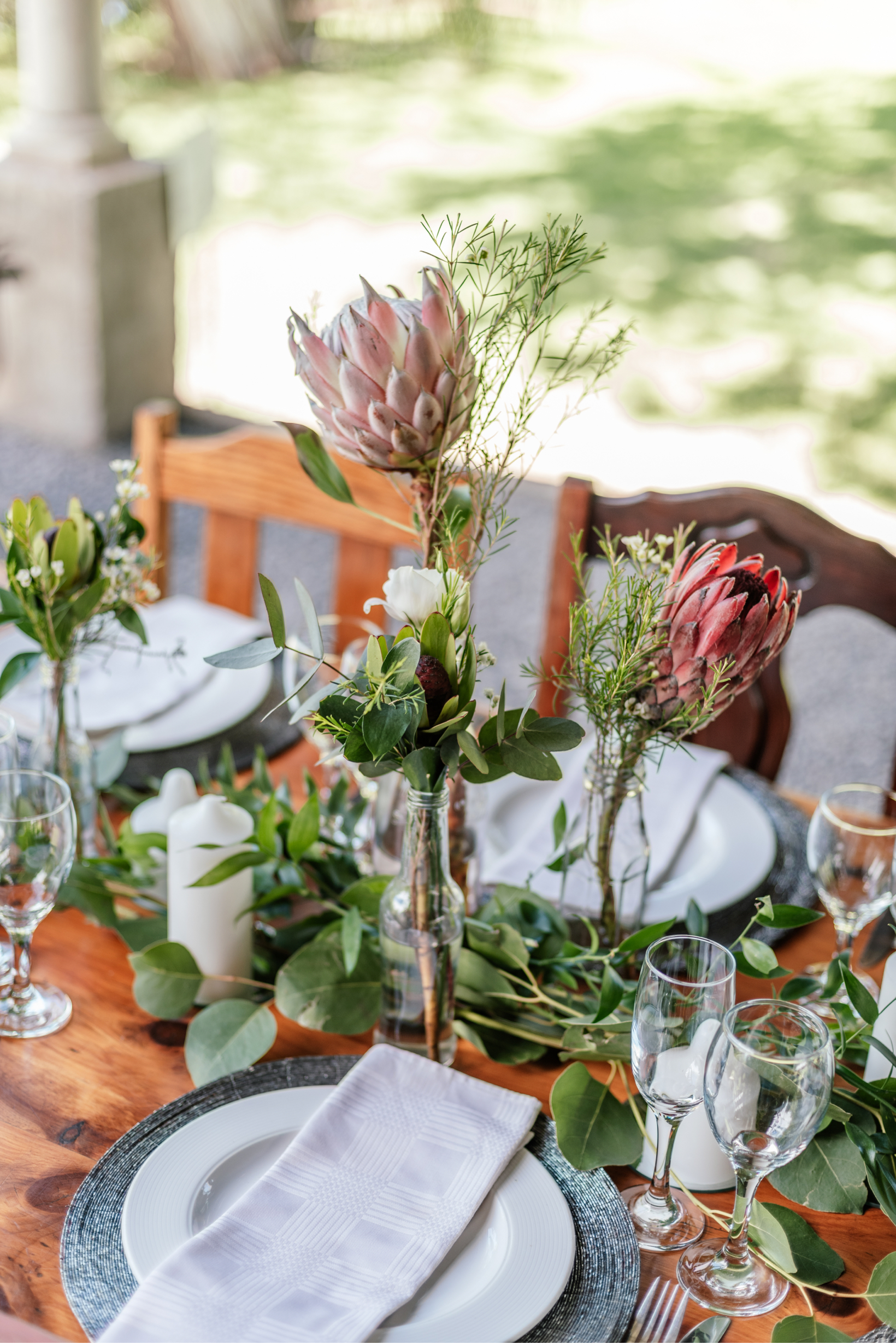 dinner table arrangement with protea